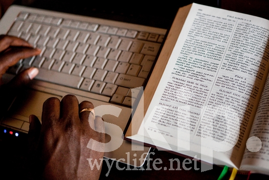 Africa;Amharic;Basketo;Bible;Ethiopia;Ethiopic script;amh;book;bst;computer;desk;hands;keyboard;male;man;office;ring;technology;translation
