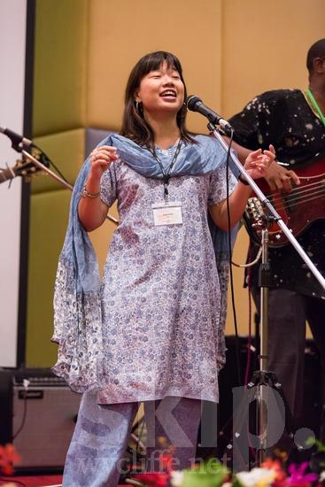Asian;ICON;Look!2012;Malaysian;SIL International Conference;Wycliffe Global Gathering;microphone;sing;woman