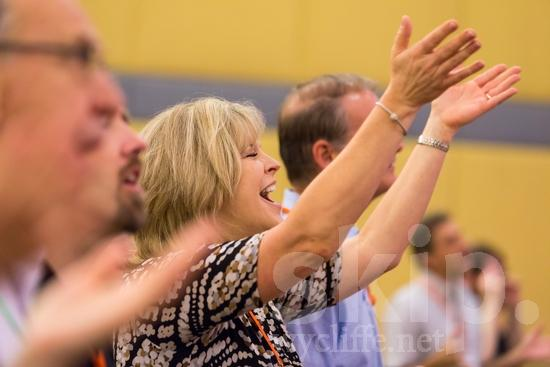 American;ICON;Look!2012;North American;SIL International Conference;Wycliffe Global Gathering;hand raised;sing;woman