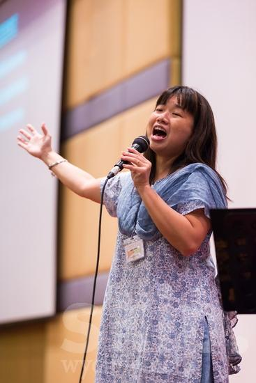 Asian;ICON;Look!2012;Malaysian;SIL International Conference;Wycliffe Global Gathering;hand raised;microphone;sing;woman