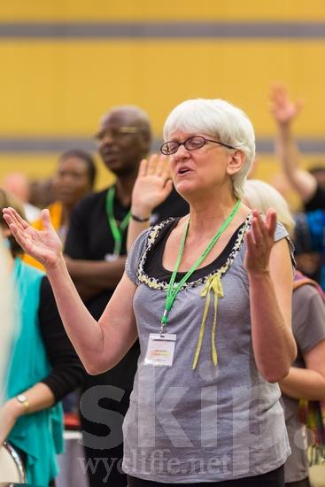 American;ICON;Look!2012;North American;SIL International Conference;Wycliffe Global Gathering;glasses;hand raised;woman
