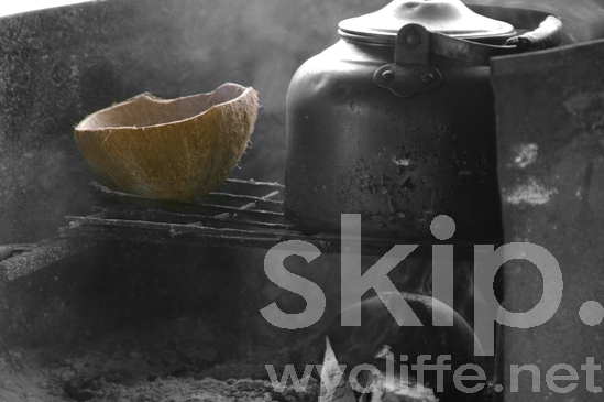 Black;Bush Kitchen;Coconut;Coconut Shell;Cooking;Fire;Kettle;Melanesian;PNG;Pacific;Pacific Islands;Papua New Guinea;Smoke