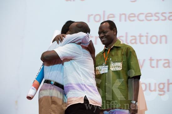 African;Asian;Cameroonian;ICON;Indian;Look!2012;Man;SIL International Conference;Wycliffe Global Gathering;africain;africaine;africana;africano;hombre;homem;homme;hug;smile;アフリカ人;男人;男性;非洲人