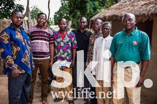 CAR;Central African;Gbaya-Bossangoa;Male;gbp;glasses;group portrait;house;men;pastor;standing