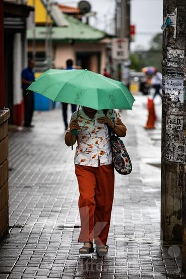 Central America;Costa Rica;San Jose;rain;street;street photography;umbrella;walking;woman