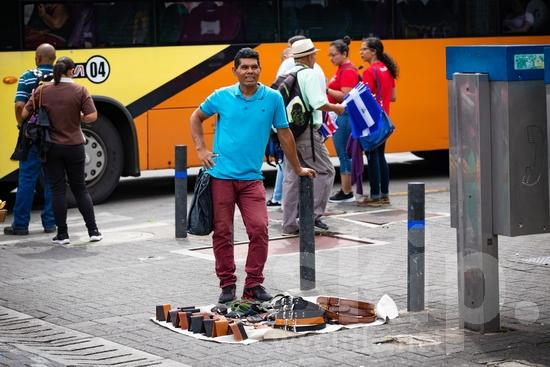 Central America;Costa Rica;San Jose;belts;man;sell;smile;street photography;wallets