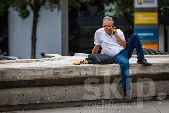 Central America;Costa Rica;San Jose;man;phone;sitting;street photography
