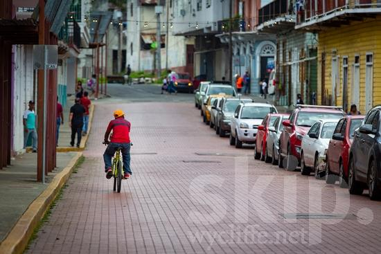Central America;Panama City;bicycle;cars;man;newspaper;street