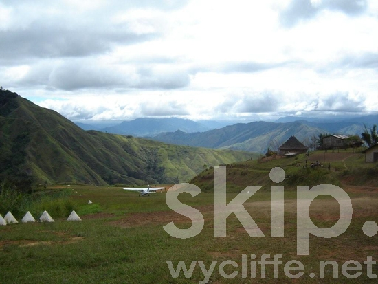Aeroplane;Airplane;Airport;Aviation;Grass;Highlands;Hut;Huts;Melanesian;Mountains;PNG;Pacific;Pacific Islands;Papua New Guinea;Plane;Runway;Scenic;Take Off;Transport;Transportation;Village