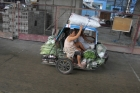 tricycle;woman;transportation;